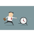 Businessman chasing a running clock vector image