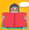 pop art surprised man holding book vector image vector image
