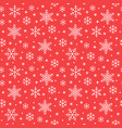 seamless pattern with white snowflakes on red vector image vector image