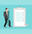 businessman is standing near checklist holding vector image vector image