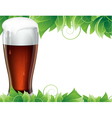 Glass of beer with green leaves vector image