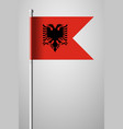 flag of albania national flag on flagpole vector image