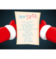 Santa holding a letter vector image vector image