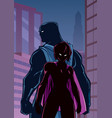 superhero couple in city silhouette vector image vector image