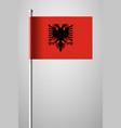 flag of albania national flag on flagpole vector image