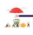 insurance agent holding umbrella over money vector image