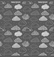 seamless background with doodle clouds on black vector image vector image