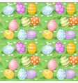 multi-colored easter eggs hidden in green grass vector image vector image