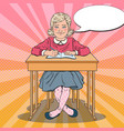 pop art schoolgirl sitting at school desk vector image vector image