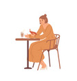 young woman sitting at table in cafe reading book vector image vector image
