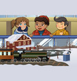 kids looking at miniature train vector image