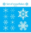A set of white snowflakes on a blue vector image vector image