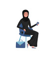 muslim business woman sitting on chair and holding vector image vector image
