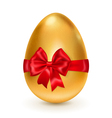 Golden egg with red bow vector image vector image