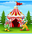 cartoon happy clown on the circus tent background vector image
