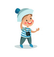 Cute little boy in sailors costume playing with