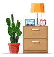 cabinet with lamp clock picture frame and plant vector image