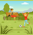 little boy playing with ball on the lawn his mom vector image vector image