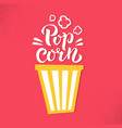 pop corn lettring sign with striped bucket of vector image vector image