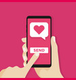 sending love message hand holding phone vector image vector image