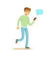 young man walking and sending a message to someone vector image vector image