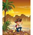 A young cowboy at the desert near the rocks vector image