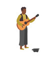 man plays guitar on street busker performance vector image
