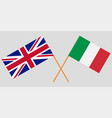 the crossed uk and italy flags vector image vector image