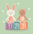 alphabet blocks with bear and rabbit stuffed vector image vector image