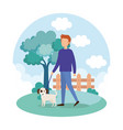 young man with dog in the park vector image