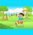 boy playing a kite at city park vector image