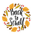 back to school calligraphic phrase on autumn vector image