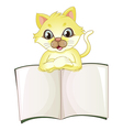 A cute yellow cat opening an empty book vector image vector image