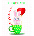 rabbit holding red heart balloon sitting in green vector image