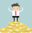 Businessman standing on gold coin vector image vector image