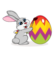 Cute rabbit painting an Easter egg vector image vector image