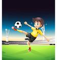 a boy in yellow uniform playing soccer