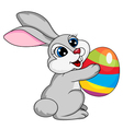 Cute rabbit holding ester egg vector image vector image