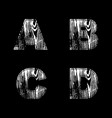 abcd letters white on a black background wood vector image vector image