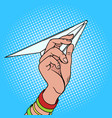 hand launches paper airplane pop art vector image vector image