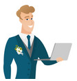 young caucasian groom using a laptop vector image vector image