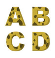 a b c d letters with leaves of trees on them vector image vector image