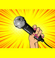 woman pop art hand hold microphone vector image
