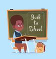 small african american school boy sit at desk over vector image vector image