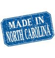 made in north carolina blue square grunge stamp vector image vector image
