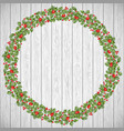 festive holiday wreath on a rustic wooden vector image