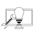 computer light bulb and wrench in black and white vector image vector image