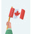 canadian flag holding in hand vector image