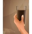 hand holding a cup of cocoa vector image