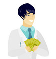 young asian doctor holding money vector image vector image